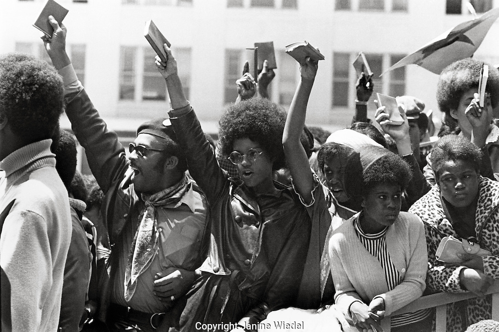 "Holding up Mau's ""Little red book"" Black Panther / Power Rally to Free Huey Newton in San Francisco California in May 1969"