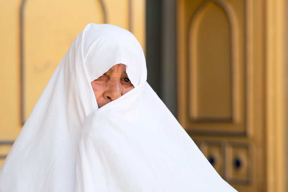 In contrary to the rest of Iran, women typically wear white chadors, rather than black ones. There are basically three theories so far to describe the whiteness of women's clothes in Varzaneh. Some believe that this harks back to the Zoroastrianism religion, for which white was a holy colour. Others believe that it is because of the abundance of cotton in this region, as people have been cultivating cotton here. While some people simply think white is a comfortable colour due to hot summers.