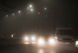 © Licensed to London News Pictures. 19/12/2017. London, UK. Traffic makes it's way through heavy fog in Acton, west London as mist and fog hit the capital city. The Met Office has issued weather warnings for freezing fog in parts of the UK, with cancellations expected at Heathrow Airport. Photo credit: Ben Cawthra/LNP