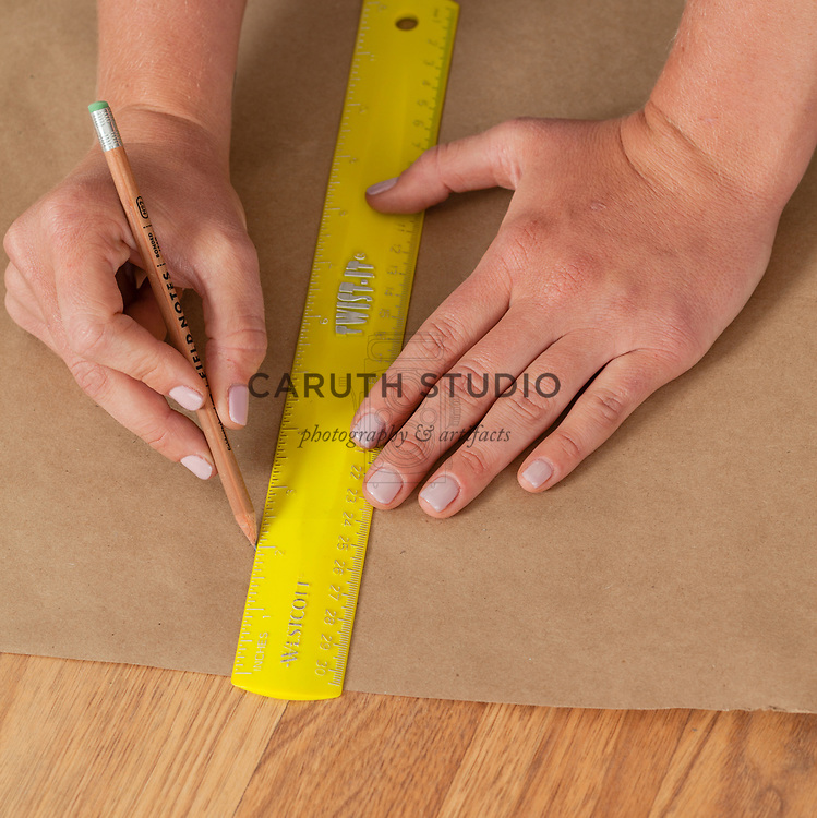 Marking hanging measurement onto kraft paper hanging template