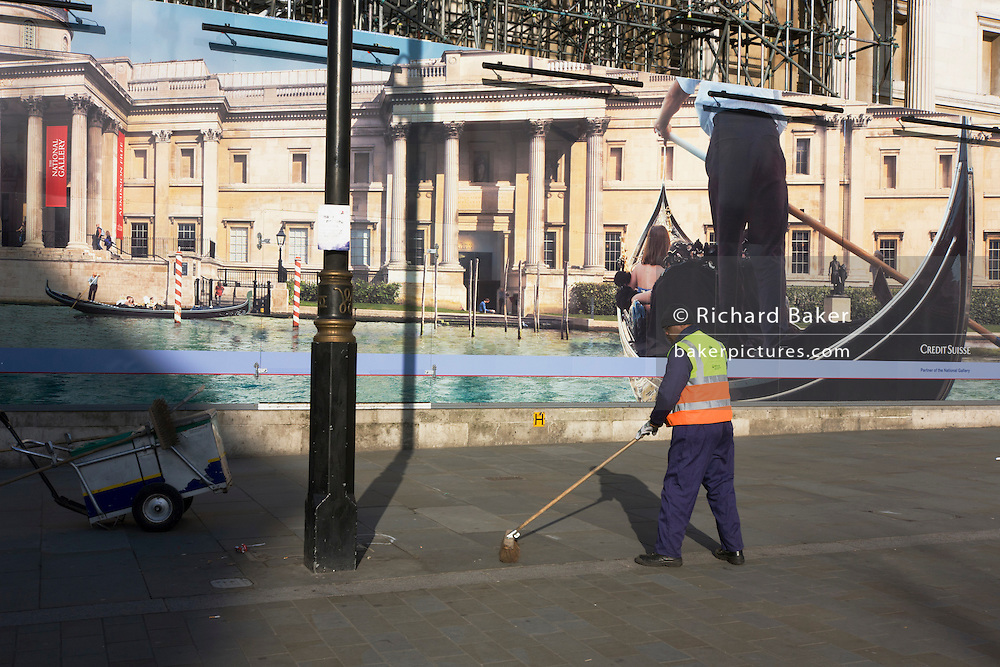 Street sweeper echoes Venice gondoleer on hoarding of  Credit Suisse-sponsored Canaletto exhibition, National Gallery.