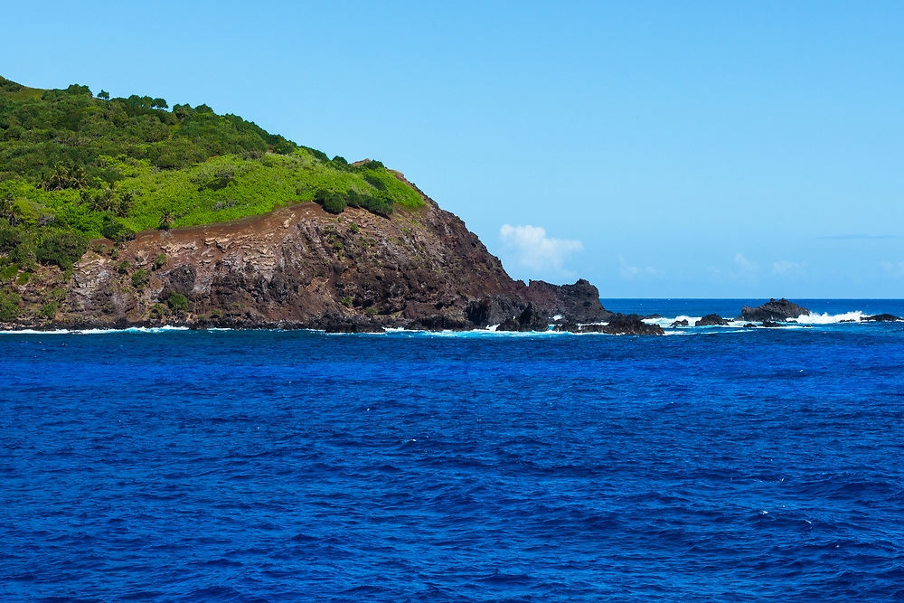 A tip of Pitcairn Island, the home of the descendants of the Mutiny on the Bounty, juts out to sea.