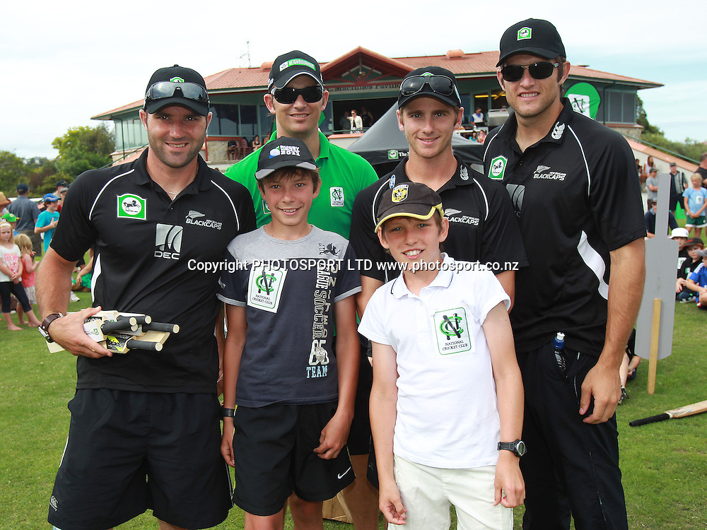 Luke Woodcock, Shane Bond, Kane Williamson and Hamish Bennett pose for a picture with two young fans at the National Bank's National Cricket Club ( NCC ) Supercamp, Nelson Park, Napier, Sunday 30 January 2011. Photo: Andrew Cornaga/photosport.co.nz