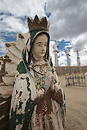 Virgin de Guadalupe statue in the St. Mary's Cemetery in Bloomfield, NM, next to a Conoco-Phillips San Juan Gas Plant. Bloomfield is in the northwestern part in New Mexico in the San Juan Basin.