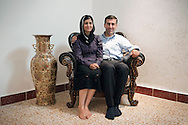 Erbil, Iraqi Kurdistan. A just married young couple in their new house. The man, Hajar, works for the Italian consulate. His wife, Nakshin, is an English teacher at high school.