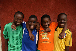 "Boys from ""Fondation Libiih Thomas"" the next generation of hopefuls. They were the lucky ones chosen to participate in a world youth tournament in France in 2007: Nyemeck Ndjebet, 12, Raoul Emeran Evegue, 12, Emmanue Meka Essiane, 12, Darel Bad, 13. Yaounde, Cameroon."