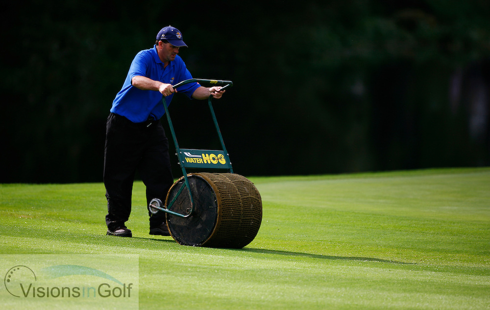squeegy removing waterlogged grass<br /> on the final day at the 36th Ryder Cup Matches 2006, K Club, Ireland, 060924<br /> Picture Credit: Mark Newcombe / visionsingolf.com