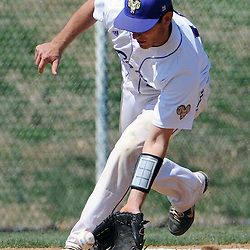 Staff photos by Tom Kelly IV<br /> WCU third baseman Chris Pula (14) fields a ground ball before throwing the batter out at first base during the first game of the Lock Haven at West Chester University baseball double-header, Saturday afternoon April 12, 2014.
