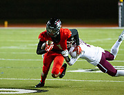 Westmoore's #1,  Tre'von Pierre breaking away from Jenks's #44, James Pruit's tackle during the game on, Thursday, November 1, 2018 at Moore Stadium.