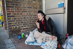 "Rough sleeper Stephanie, 34, as her pitch outside the post office on Peascod Street. After a public outcry against their ""homelessness support strategy"" where rough sleepers would have been fined £100, Windsor council has shelved their plans. Windsor, Berkshire, February 16 2018."