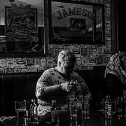 A bar patron spends her Saturday night at a pub in a Loyalist stronghold of  Londonderry. Northern Ireland, September 2019