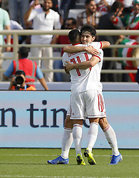 2019?1?12?.   ??????1???——D??????????.    1?12??????????·??????????????.    ??????????????2019???????D??????????????.    ????????..(SP)UAE-AL AIN-SOCCER-AFC ASIAN CUP 2019-GROUP D-VNM VS IRN..(190112) -- ABU DHABI, Jan. 12, 2019  Iran's Sardar Azmoun (back) celebrates after scoring during the 2019 AFC Asian Cup group D match between Vietnam and Iran at the Al Nahyan Stadium in Abu Dhabi, the United Arab Emirates, Jan. 12, 2019. (Credit Image: © Xinhua via ZUMA Wire)
