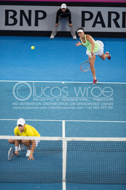 Casey Dellacqua (AUS) and Ashleigh Barty (AUS), April 20, 2014 - TENNIS : Fed Cup, Semi-Final, Australia v Germany. Pat Rafter Arena, Brisbane, Queensland, Australia. Credit: Lucas Wroe