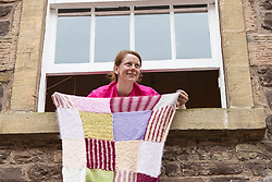 Yarn bombing during the Scotland-wide World Heritage Day festivities. Six unique events, coordinated by Dig It! 2017, celebrated Scotland's six World Heritage Sites as part of the 2017 Year of History, Heritage and Archaeology. <br /> <br /> Pictured: Event Manager Lindsay McGhie hanging out patchwork quilt and vines from one of the windows of the institute