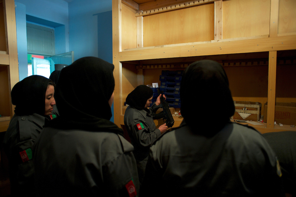 Afghan National Police (ANP) female cadets inspection the arms deposit at the Afghan Nacional Police Academy in Kabul.