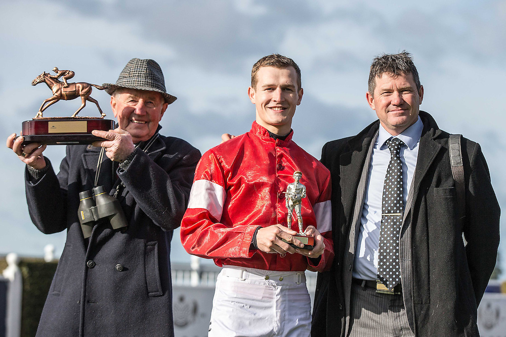 Jockey Michael Mitchell, centre, poses with trainers Brian and Shane Anderton after High Forty winning race 7 141st NZ Grand National Steeplechase at Riccarton Park, Christchuch, New Zealand, Saturday, August 08, 2015. Credit:SNPA / Martin Hunter