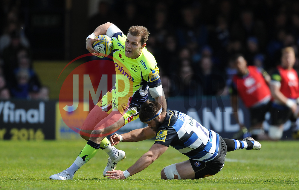 Will Addison of Sale Sharks is tackled by Guy Mercer of Bath Rugby.  - Mandatory by-line: Alex Davidson/JMP - 23/04/2016 - RUGBY - Recreation Ground - Bath, England - Bath Rugby v Sale Sharks - Aviva Premiership
