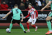James Clarke and Alfie May  during the EFL Sky Bet League 2 match between Cheltenham Town and Walsall at Jonny Rocks Stadium, Cheltenham, England on 11 January 2020.
