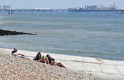 © Licensed to London News Pictures. 24/04/2020. Brighton, UK. People sunbathing on Brighton seafront at Brighton and Hove, during a pandemic outbreak of the Coronavirus COVID-19 disease.  Photo credit: Liz Pearce/LNP