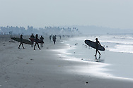Surfers on the Pacific Ocean at Topanga Beach, California