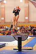 January 17, 2010; Stanford, CA, USA; Stanford Cardinal gymnast Danielle Ikoma performs on the vault during the meet against the Arizona Wildcats at Burnham Pavilion. The Cardinal defeated the Wildcats 196.025-194.675. Mandatory Credit: Kyle Terada-Terada Photo