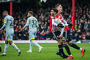 Sergi Canos (Brentford) congratulates Said Benrahma (Brentford) following his goal during the EFL Sky Bet Championship match between Brentford and Derby County at Griffin Park, London, England on 6 April 2019.