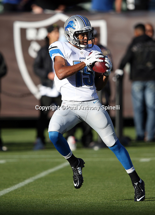 Detroit Lions wide receiver Golden Tate (15) catches a pregame pass before the 2014 NFL preseason football game against the Oakland Raiders on Friday, Aug. 15, 2014 in Oakland, Calif. The Raiders won the game 27-26. ©Paul Anthony Spinelli