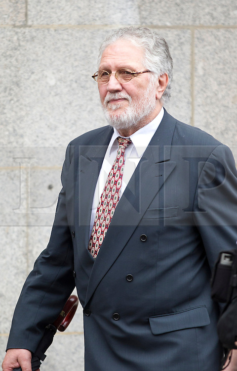 © Licensed to London News Pictures. 06/09/2013. London, UK. Former radio disc jokey Dave Lee Travis, real name David Patrick Griffin, leaves the Old Bailey in London today (06/09/2013) ahead of his trial for sexual assault. Travis, who was arrested by the Metropolitan Police as part of the Operation Yewtree inquiry, is charged with with several counts of indecent or sexual assault dating back to the 1970's. Photo credit: Matt Cetti-Roberts/LNP