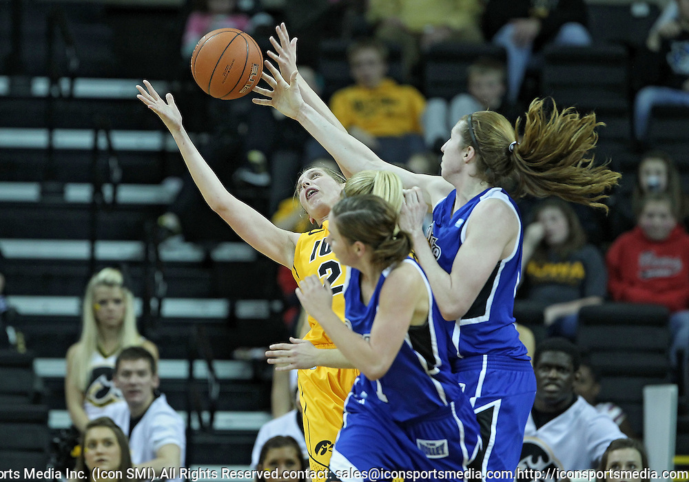 December 20, 2011: Iowa Hawkeyes forward Kelly Krei (20) and Drake Bulldogs forward Rachael Hackbarth (15) battle for a rebound during the NCAA women's basketball game between the Drake Bulldogs and the Iowa Hawkeyes at Carver-Hawkeye Arena in Iowa City, Iowa on Tuesday, December 20, 2011. Iowa defeated Drake 71-46.