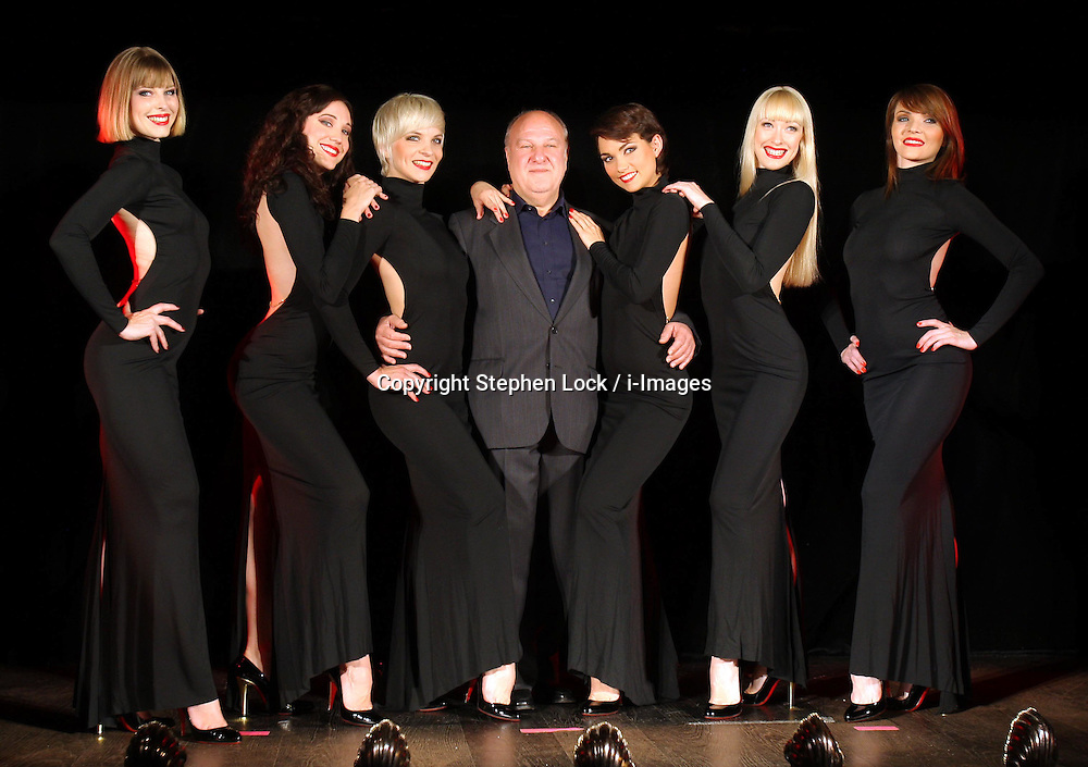 Promoter Harvey Goldsmith with six dancers from the Crazy Horse cabaret in Paris at the launch of their first ever show to be held in London , Tuesday 12th June 2012. The show entitled Forever Crazy , will run from September to December at a specially built venue on the Southbank.  Photo by: Stephen Lock / i-Images