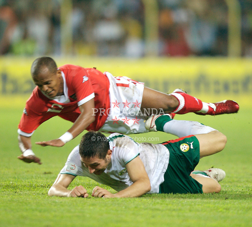 Bourgas, Bulgaria - Wednesday, August 22, 2007: Wales' Robert Earnshaw and Bulgaria's Aleksandar Tunchev during the International Friendly match at the Naftex Stadium. (Photo by David Rawcliffe/Propaganda)