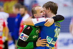 Gorazd Skof of Slovenia and Jure Dolenec of Slovenia celebrate after the handball match between Iceland and Slovenia in  3rd Round of Preliminary Round of 10th EHF European Handball Championship Serbia 2012, on January 20, 2012 in Millennium Center, Vrsac, Serbia. Slovenia defeated Iceland 34-32. (Photo By Vid Ponikvar / Sportida.com)