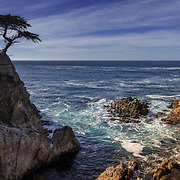 The view of Carmel Bay is a wondrous sight.  The cool Pacific breeze echoes the crashing waves along the granite rocks.  The captivating image was captured in a cool December evening in the picturesque Pebble Beach, CA.