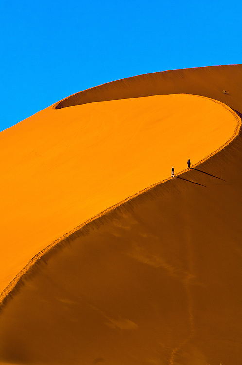 This image of the Sossusvlei Sand Dunes (highest dunes in the world), Namib Desert,  Namibia won first place in the Connecting People and Nature Category in the 2011 National Wildlife Federation photo competition.