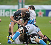13.11.2011. Glasgow, Scotland.  Heineken Cup pool 3 Rugby Union from the Firhill Stadium. Glasgow Warriors v Bath.Warriros captain takes the ball on as Ben Skirving puts in the tackle