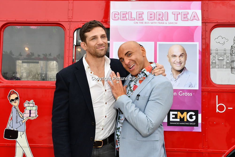 Alex Reid and Simon Gross attend Celeb Bri Tea, on board the BB Bakery bus on 22 March 2019, London, UK.