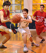 NEW HOPE, PA. - JANUARY 23: New Hope Solebury's Pat Gimpel (C) attempts to pass the ball as Holy Ghost Prep's Joe Braun (L) and Tim Brennan #20 in the first quarter at New Hope Solebury High School January 23, 2015 in New Hope, Pennsylvania. (Photo by William Thomas Cain/Cain Images)