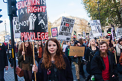 "London, November 19th 2014. Thousands of students march through central London, demanding that education fees are scrapped by the government. PICTURED: A young woman proclaims ""Education is a right not a privilege""."