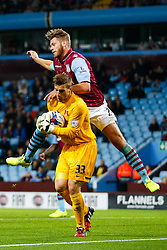 Gary Woods of Leyton Orient beats Nathan Baker of Aston Villa to a cross - Photo mandatory by-line: Rogan Thomson/JMP - 07966 386802 - 27/08/2014 - SPORT - FOOTBALL - Villa Park, Birmingham - Aston Villa v Leyton Orient - Capital One Cup Round 2.