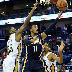 Oct 4, 2016; New Orleans, LA, USA;  Indiana Pacers guard Monta Ellis (11) is defended by New Orleans Pelicans guard E'Twaun Moore (55) and center Alexis Ajinca (42) during the first quarter of a game at the Smoothie King Center. Mandatory Credit: Derick E. Hingle-USA TODAY Sports