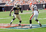 CLEVELAND - SEPTEMBER 10:  Rookie running back Reggie Bush #25 of the New Orleans Saints goes out for a pass while rushing, receiving, and returning punts for 141 total yards in his regular season professional debut against the Cleveland Browns at Cleveland Browns Stadium on September 10, 2006 in Cleveland, Ohio. The Saints defeated the Browns 19-14. ©Paul Anthony Spinelli *** Local Caption *** Reggie Bush