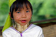 young girl with neck rings and flower body paint Chiang Mai,  Thailand