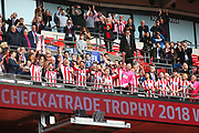 Lincoln City's Luke Waterfall lifts the Checkatrade trophy during the EFL Trophy Final match between Lincoln City and Shrewsbury Town at Wembley Stadium, London, England on 8 April 2018. Picture by John Potts.