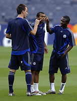 Photo: Richard Lane.<br />Chelsea training session. UEFA Champions League. 30/10/2006. <br />Chelsea captain Ashley Cole has his ears flicked by John Terry and Shaun Wright-Phillips (rt)  during a training ground game.