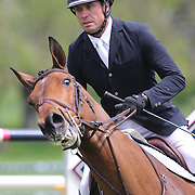 Devin Ryan riding Liratus in action during the $35,000 Grand Prix of North Salem presented by Karina Brez Jewelry during the Old Salem Farm Spring Horse Show, North Salem, New York, USA. 15th May 2015. Photo Tim Clayton