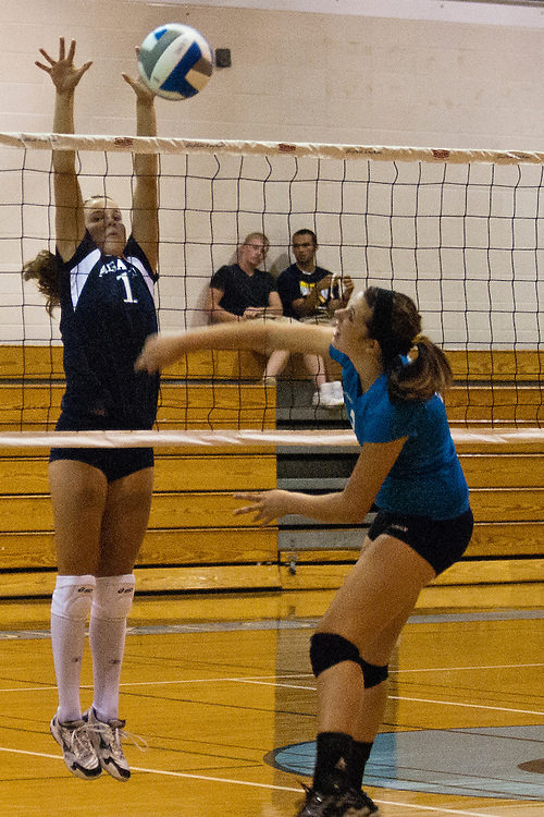 Lathan Goumas | The Bay City Times..Michelle Kleinau, of the All Saints High School Volleyball team, goes up to block the ball during a Volleyball Tournament at Garber High School in Essexville, MI., on Tuesday August 23, 2011.