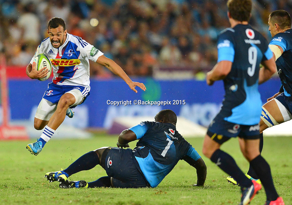 Dillyn Leyds of the Stormers jumps over Trevor Nyakane of the Bulls during the 2015 Super Rugby rugby match between the Bulls and the Stormers at Loftus Versfeld in Pretoria, South Africa on February 14, 2015 ©Barry Aldworth/BackpagePix