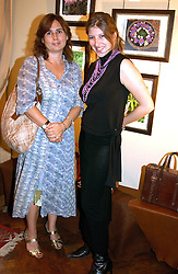 Left to right, ALEXANDRA SHULMAN and TARA SUMMERS daughter of Martin Summers at a an exhibition of prints by art dealer Martin Summers held at 73 Glebe Place, London on 29th June 2004.