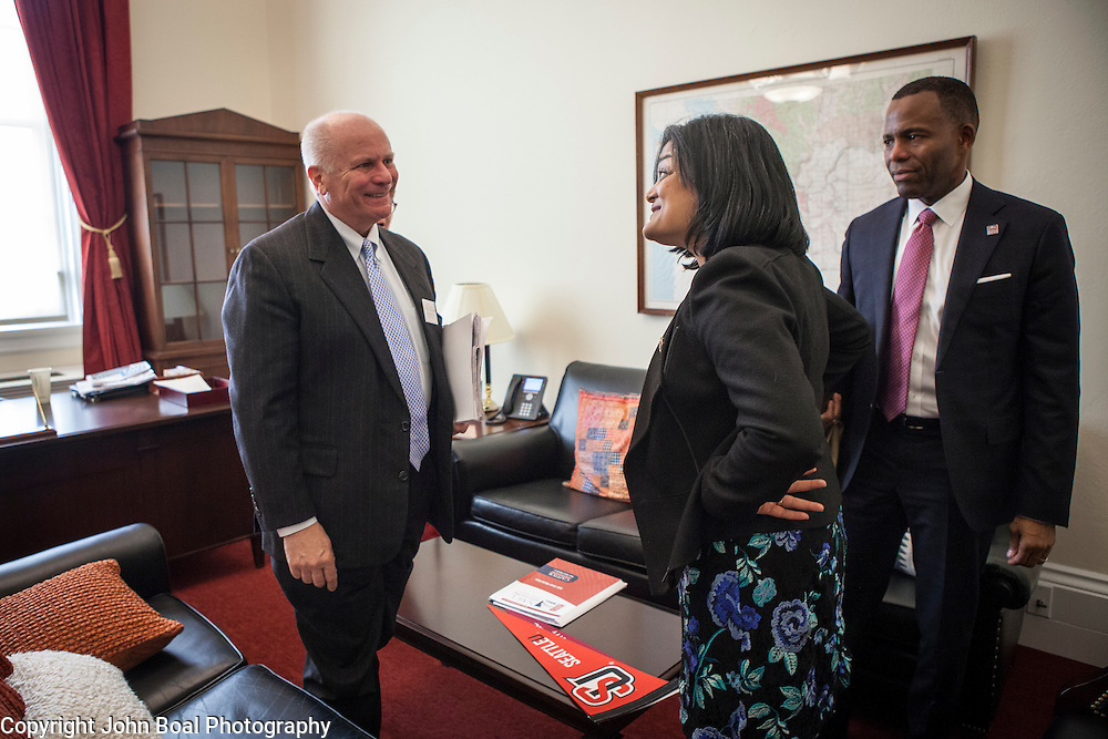Representative Pramila Jayapal (D-WA, 7), finishes a meeting with Larry Probus, left, and Isiaah Crawford, of the National Association of Independent Colleges and Universities, on Tuesday, January 31, 2017.  The meeting was one of four 30-minute meetings with constituent advocacy groups during the day.  John Boal photo/for The Stranger