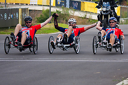 Queen Elizabeth Olympic Park, London. September 13th 2014. In the Recumbent IRecB1category, Robert Cromey-Hawke (R), John-James Chalmers (L) and Paul Vice (C) cross the finish line together to take victory as wounded servicemen and women from 13 different countries compete for sporting glory during the cycling competition at the Invictus Games.